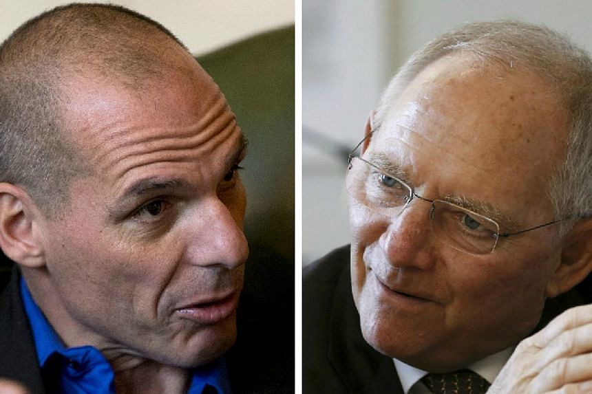 Greece's new finance minister Yanis Varoufakis (left) will meet his German counterpart Wolfgang Schaeuble on Thursday. Germany is seen as the strongest opponent of any easing in the terms of Greece's massive debts. -- PHOTOS: BLOOMBERG, REUTERS
