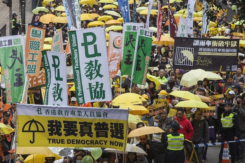 Protesters from Hong Kong's Umbrella Movement marching on Feb 1, 2015. -- PHOTO: EPA