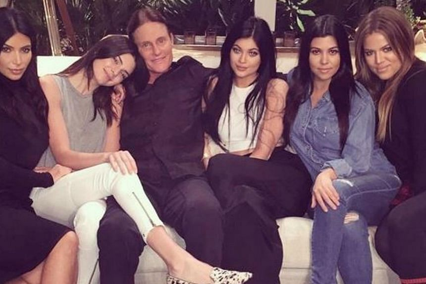 Bruce Jenner (third from left) sits with his daughters, Kendall and Kylie Jenner, and former step daughters, Kim, Kourtney and Khloe Kardashian.-- PHOTO: KHLOE KARDASHIAN/ INSTAGRAM
