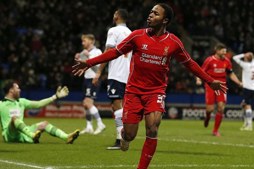 Liverpool's Raheem Sterling celebrates after scoring during their FA Cup fourth round replay soccer match against Bolton Wanderers at the Macron Stadium in Bolton, northern England on Feb 4, 2015. -- PHOTO: REUTERS
