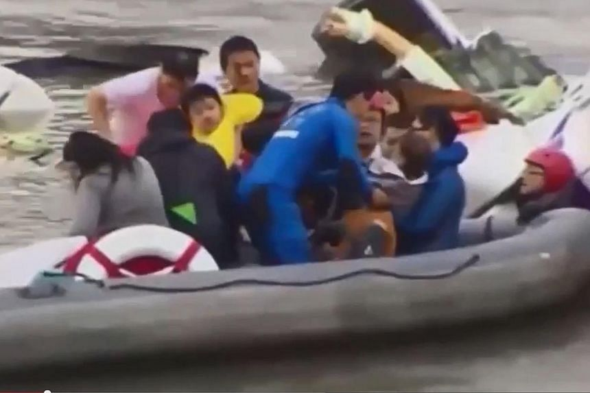 A two-year-old taken to shore after being rescued on Wednesday. -- PHOTO: SCREENGRAB FROM YOUTUBE/ANEMIX LOST VIRAL
