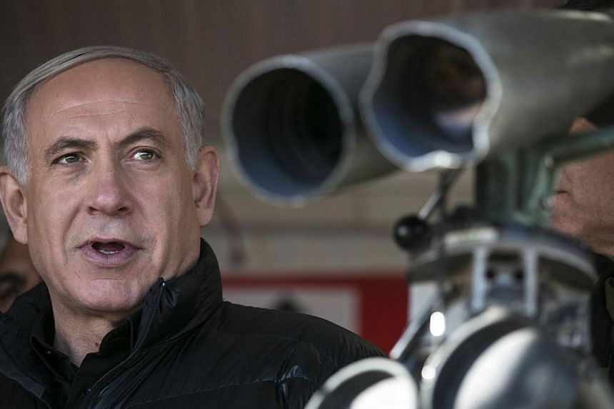Israel's Prime Minister Benjamin Netanyahu looks on at a military outpost on Feb 4, 2015, during a visit at Mount Hermon which sits in the Israeli occupied Golan Heights on the border between Lebanon, Syria and Israel.An Israeli ambassador and