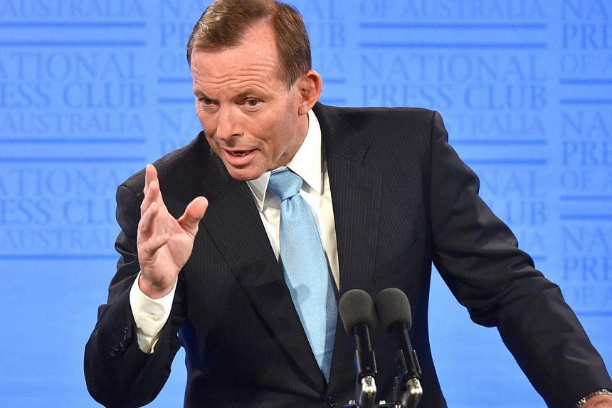 "Defiant Australian Prime Minister Tony Abbott on Thursday said he was ""very confident"" he will still be in charge next week after a top Liberal figure fuelled speculation he may be toppled. -- PHOTO: BLOOMBERG"