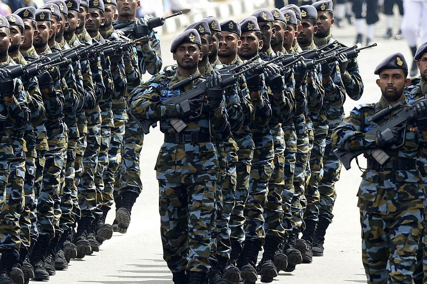 Sri Lankan military personnel march past during the country's 67th Independence Day celebrations in Colombo on Feb 4, 2015. Sri Lanka's new President Maithripala Sirisena has renewed orders allowing for troops to be deployed across the island, dampen
