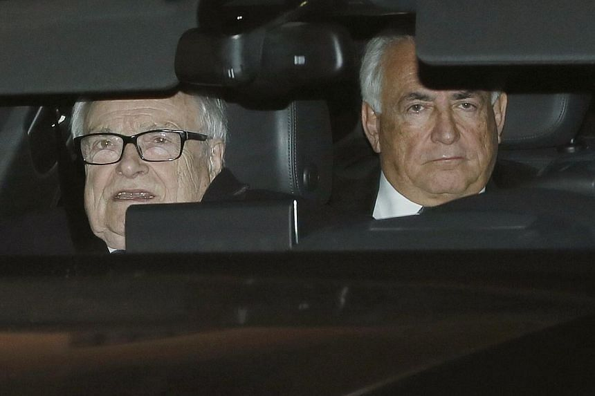Former IMF head Dominique Strauss-Kahn (right) rides in the backseat of a car as he leaves with Henri Leclerc (left), one of his lawyers, after the first day of trial in the so-called Carlton Affair, in Lille, Feb 2, 2015.Sri Lanka's new govern