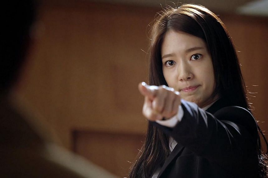 Park Shin Hye plays a zealous TV reporter who cannot lie without hiccupping in K-drama Pinocchio. -- PHOTO: ONE