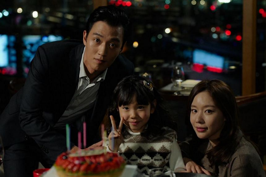In Punch, a prosecutor (Kim Rae Won, left) learns he has a brain tumour and decides to bring down his corrupt boss with help from his former wife and fellow prosecutor (Kim Ah Jung, right, with Kim Ji Young, who plays their daughter). -- PHOTO: ONE