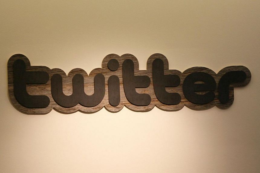 TheTwitter logo displayed at the entrance of Twitter headquarters in San Francisco,California. Twitter Inc. has struck a deal with Google Inc. to make its 140-character updates more searchable online. -- PHOTO: AFP