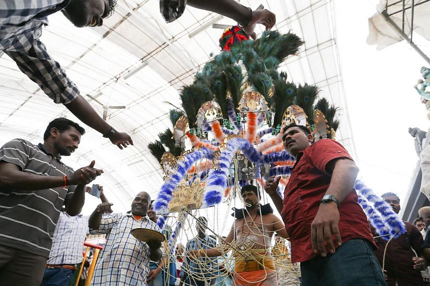 A devotee with his kavadi at Sri Srinivasa Perumal Temple during Thaipusam. The ban on musical instruments during the Thaipusam procession was introduced because of past incidents of fights between competing groups which disrupted the procession, sai