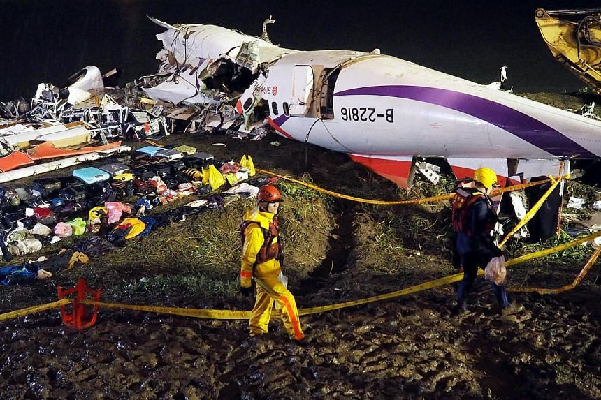 The wreckage of the TransAsia Airways flight GE235 passenger plane that crashed into the Keelung River lying on the banks of the river in Taipei on Feb 5, 2015. -- PHOTO: EPA