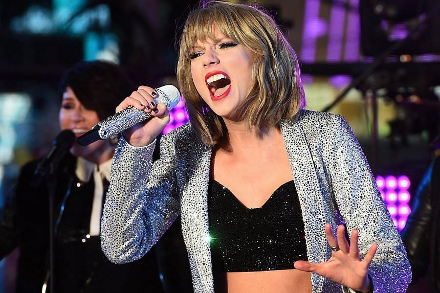 Taylor Swift's 1989 regained the top spot in the weekly Billboard 200 album chart, giving the pop star the distinction of being the second woman in history to have two albums hit No.1 for at least 10 weeks, Billboard says on Wednesday. -- PHOTO: AFP