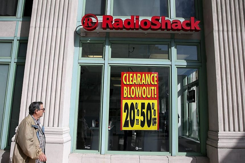 A sign reading, 'Clearance Blowout', is seen in the window of a RadioShack store on Feb 3, 2015 in Miami, Florida. Reports indicate that the New York Stock Exchange will suspend trading in RadioShack and delist the stock as the company may shut down