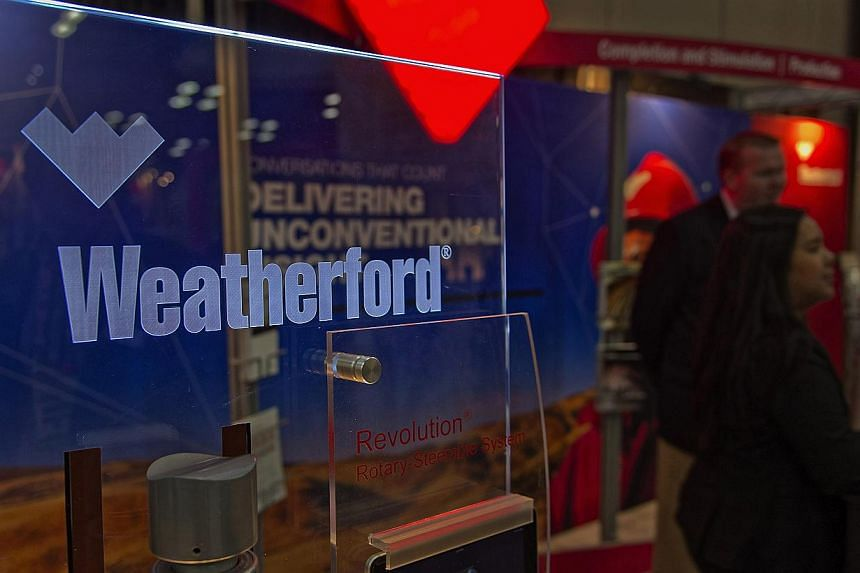 Swiss- based oilfield service company Weatherford International will cut 5,000 positions by the end of the first quarter, after the plunge in crude oil prices. -- PHOTO: BLOOMBERG