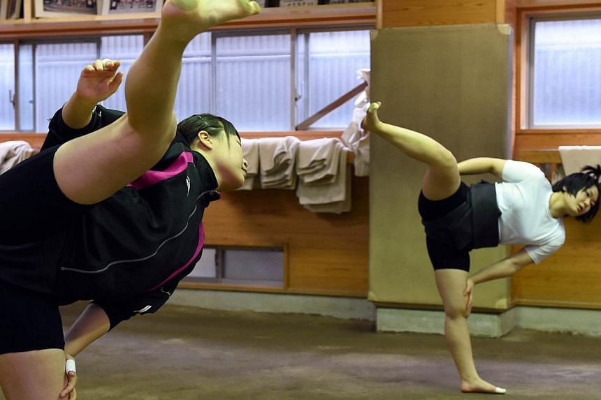 Female sumo wrestlers Shiori Kanehira (left) and Sayaka Matsuo attending a training session at Nihon University's sumo club in Tokyo. -- PHOTO: AFP