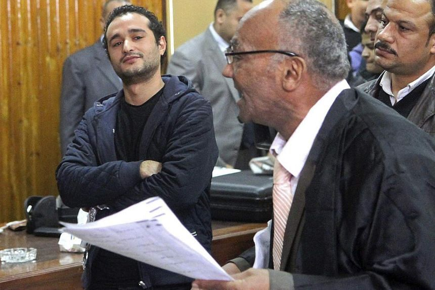 Egyptian political activist Ahmed Douma (left) attends his trial in Cairo, Feb 4, 2015. -- PHOTO: REUTERS