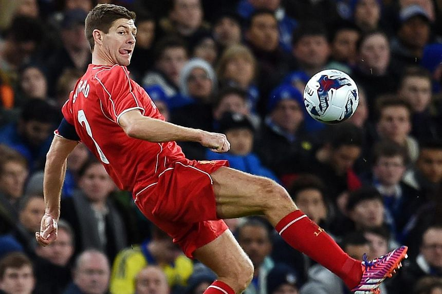 Liverpool captain Steven Gerrard (above) became just the third player in the club's history to make 700 appearances for the Merseysiders when he was included in the starting side to play Bolton Wanderers in a FA Cup fourth-round replay at the Macron