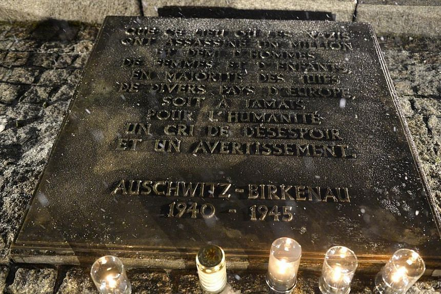A plaque for victims of the Holocaust is seen on Jan 27, 2015 at the former Nazi concentration camp Auschwitz-Birkenau in Oswiecim, Poland. -- PHOTO: AFP