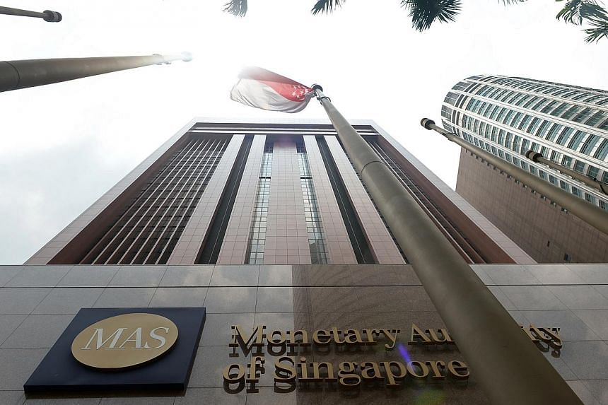 Singapore's financial regulators have rolled out a set of proposals aimed at fixing a problem that has long plagued the financial industry - bad writing. -- ST PHOTO:NG SOR LUAN