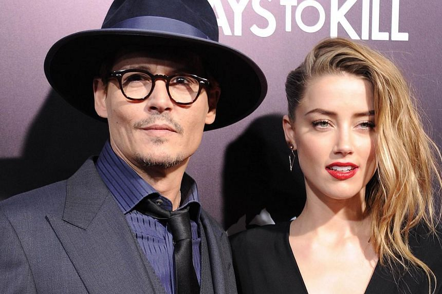 Actor Johnny Depp and actress Amber Heard made their marriage official at their home on Tuesday, ahead of their wedding on his private island in the Bahamas this weekend, says People magazine. -- PHOTO: AFP