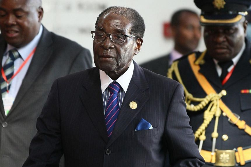 Zimbabwe's 90-year-old President Robert Mugabe (pictured above, in January) fell down a staircase on Wednesday as he walked off a podium after addressing supporters at Harare international airport, an AFP correspondent said. -- PHOTO: REUTERS