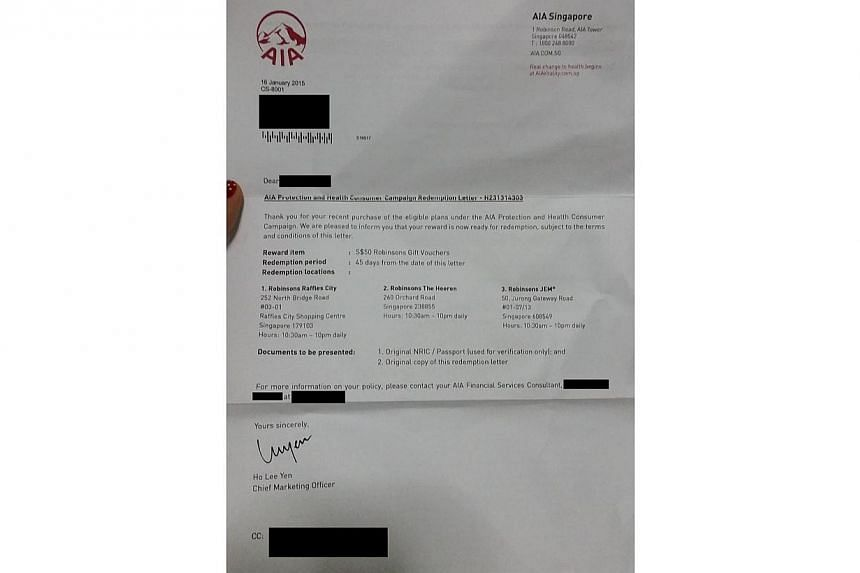 A redemption letter for a $50 shopping voucherthat was sent to photographer Ng.-- PHOTO: GRACE TAN