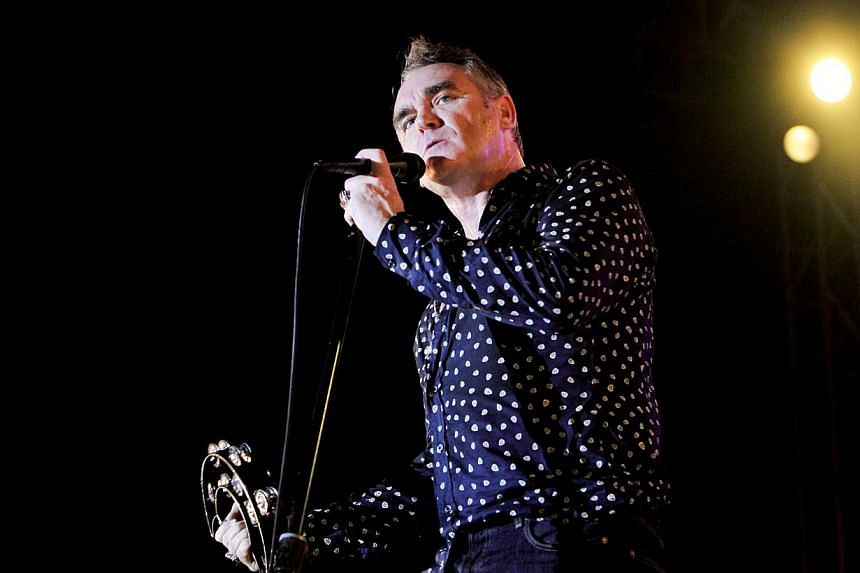 British rock legend Morrissey (above) pulled out of plans for a concert in Iceland because the venue included a restaurant selling meat, his local promoter said Wednesday. -- PHOTO:LAMC PRODUCTIONS