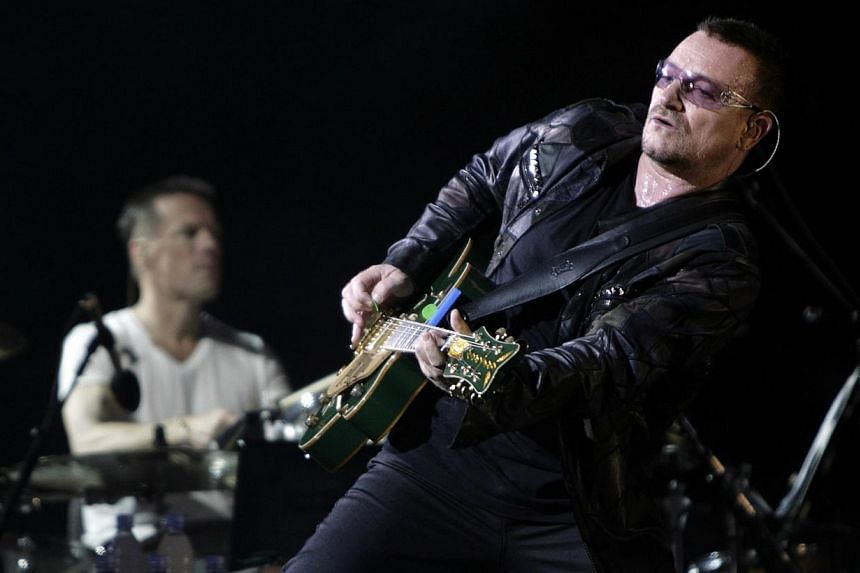 Lead singer Bono of the rock band U2 performing with the band in Chicago in a 2009 file photo. Irish rock group U2 said Wednesday it was adding two dates in London and Barcelona to its Europe and North America tour this year after concerts sold