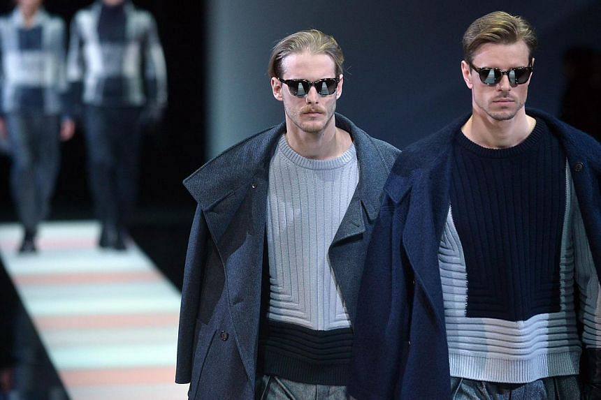 Model present creations part of the Giorgio Armani collection show during the Fall/Winter 2015 Men's Fashion Week on Jan 20, 2015, in Milan. New York will cement its status as world fashion capital in July by launching a men's fashion week to sh