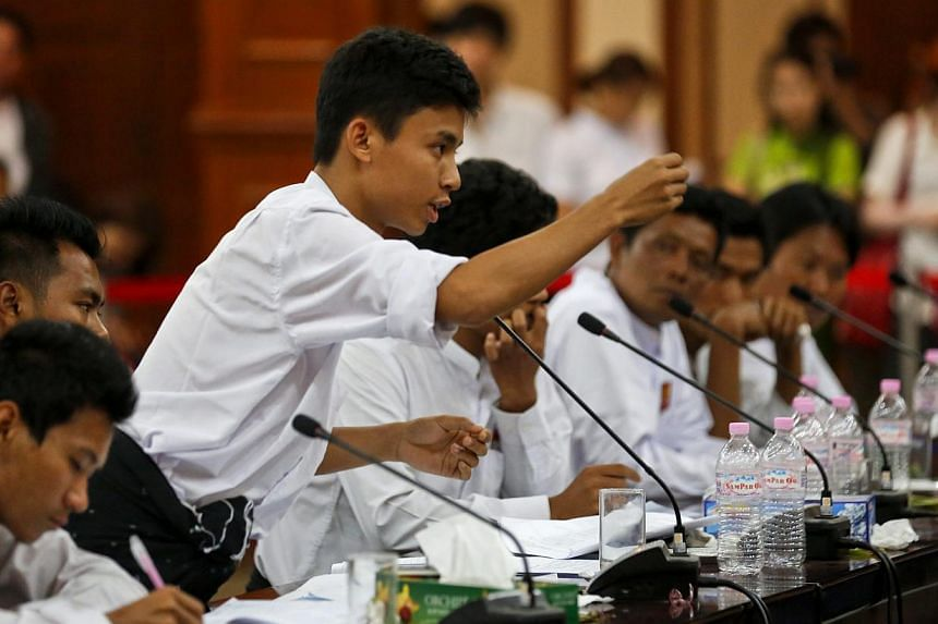 Young student representatives in action at an open talk over the National Education Bill which is due to be passed by parliament in Yangon, Myanmar onFeb 1,2015. -- PHOTO: EPA