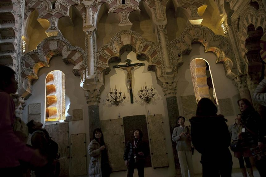 Tourists visit the Mosque-Cathedral of Cordoba on Mar 4, 2014. -- PHOTO: AFP