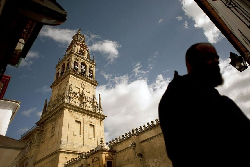A visitor walks in the Mosque-Cathedral of Cordoba on March 4, 2014. -- PHOTO: AFP
