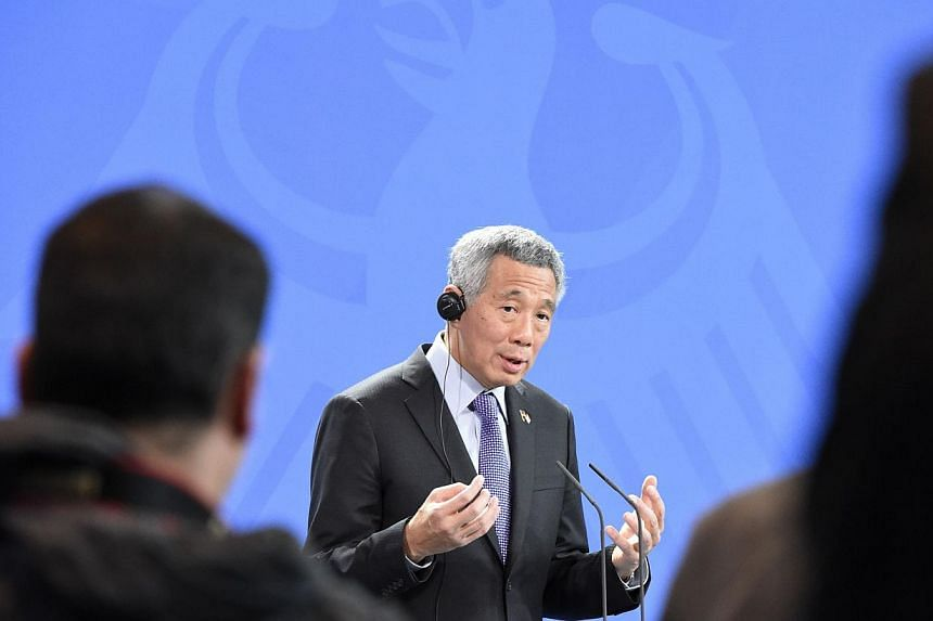 Prime Minister Lee Hsien Loong addressing a news conference at the Chancellery in Berlin on Feb 3, 2015. -- PHOTO: REUTERS