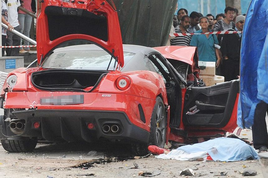The parents of the Japanese woman who was killed in a shocking car crash along Rochor Road in 2012 have reached a settlement with the insurer of Ferrari driver Ma Chi, who crashed his car into a taxi that Ms Ito was in. -- PHOTO: LIANHE WANBAO
