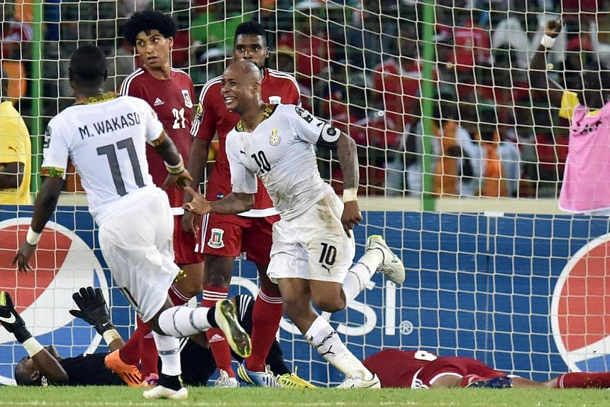 Ghana's midfielder Andre Ayew (centre) celebrates after scoring a goal during the 2015 African Cup of Nations semi-final football match between Equatorial Guinea and Ghana in Malabo on Feb 5, 2015. -- PHOTO: AFP