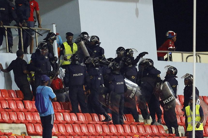 Police instruct Equatorial Guinea fans to move after some of them threw objects during their African Nations Cup semi-final soccer match against Ghana in Malabo on Feb 5, 2015. -- PHOTO: REUTERS