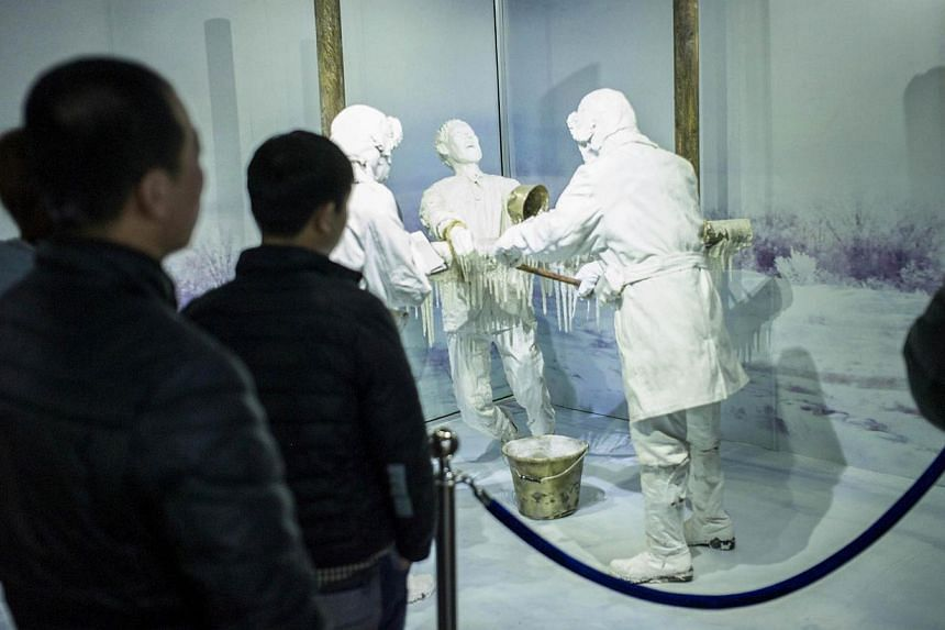 Visitors looking at a scene of human experiments at the Unit 731 museum in Harbin, north-east China's Heilongjiang province, on Jan 7, 2015. -- PHOTO: AFP