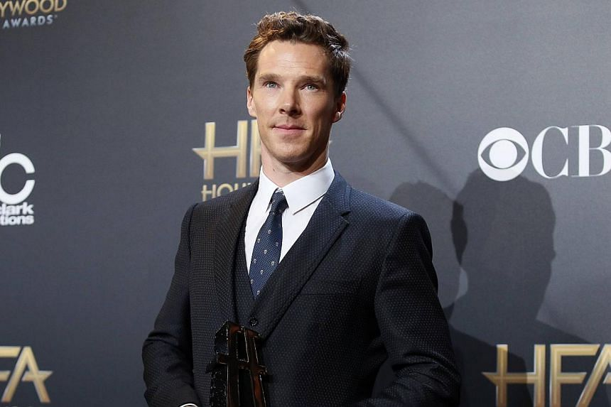 "Actor Benedict Cumberbatch posing backstage with his actor award for ""The Imitation Game"" during the Hollywood Film Awards in Hollywood, California on Nov 14, 2014. -- PHOTO: REUTERS"