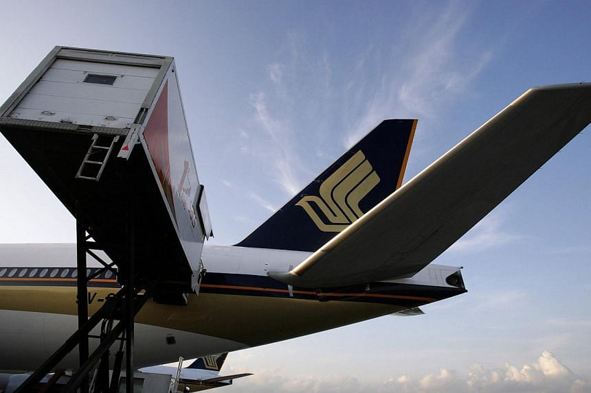 Singapore Airlines Ltd (SIA) expects earnings to be impacted by high jet fuel hedges and competition as it reported quarterly profit below market estimates. --PHOTO: REUTERS