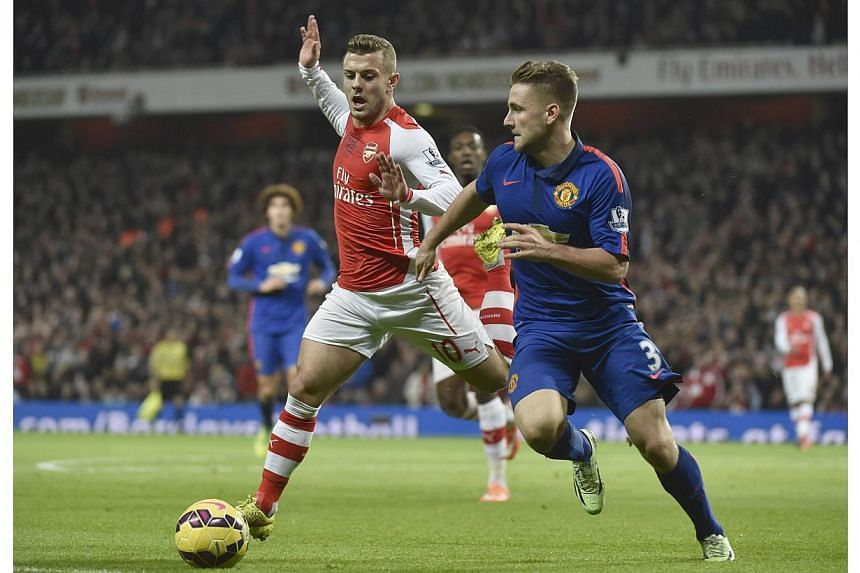 """Manchester United's Luke Shaw (right) is challenged Arsenal's Jack Wilshere during their English Premier League soccer match at the Emirates Stadium in London Nov 22, 2014. Wilshere needs to """"master his own life"""" after being pictured this week holdin"""