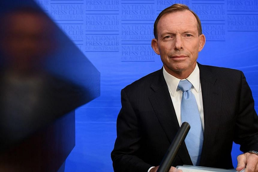 Embattled Australian Prime Minister Tony Abbott will face a vote on his leadership at a party-room meeting next week. -- PHOTO: EPA