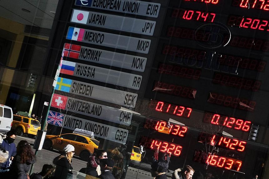 The euro was little changed at US$1.1469 after surging 1.2 per cent overnight in a short covering rally. -- PHOTO: AFP