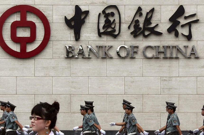 After a slew of gloomy economic data, the People's Bank of China cut banks' reserve requirement ratios by 50 basis points on Wednesday, freeing up an estimated 600 billion yuan (S$129.34 billion) into the money supply. -- PHOTO: REUTERS