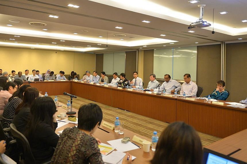 The CPF Advisory Panel holding a press conference on Feb 4, 2015 at the Ministry of Manpower. -- ST PHOTO: ALPHONSUS CHERN