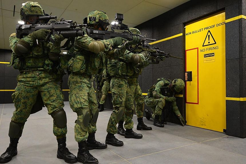 NS men in action at the SAF Multi-Mission Range Complex (MMRC) located at Pasir Laba. The Singapore Armed Forces (SAF) will be conducting military exercises at 16 places across the island from 8am on Monday, Feb 9, to 8am on Feb 16. -- ST PHOTO: CARO