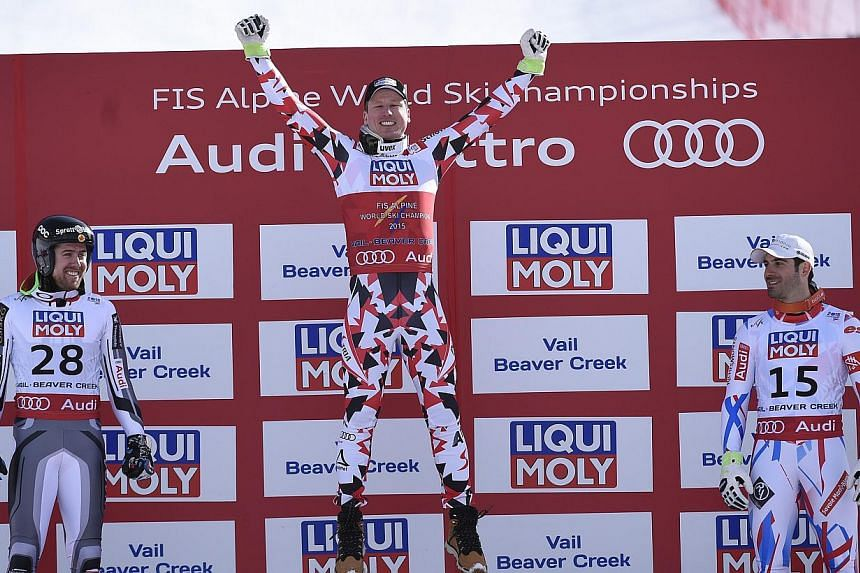 Celebrating are (from left) Dustin Cook of Canada (silver), Hannes Reichelt of Austria (gold) and Adrien Theaux of France (bronze) after the Men's Super-G at the FIS Alpine World Ski Championships in Beaver Creek, Colorado, on Feb 5 2015. -- PH