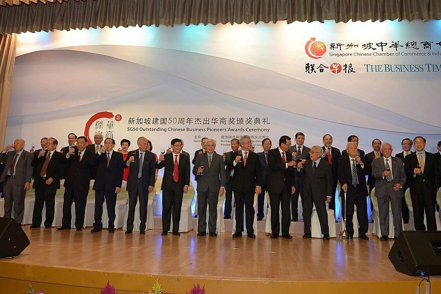 Group shot of the Pioneer Chinese businessmen giving a toast. -- ST PHOTO: DESMOND WEE