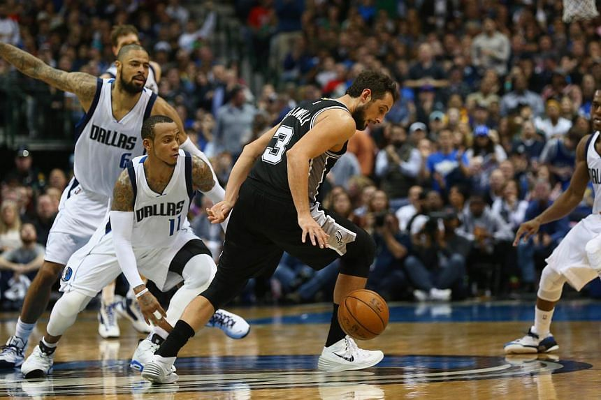 Marco Belinelli of the San Antonio Spurs dribbling the ball against Monta Ellis of the Dallas Mavericks at the American Airlines Centre on Dec 20 last year in Dallas, Texas.Belinelli will try to become the first repeat winner of the event since