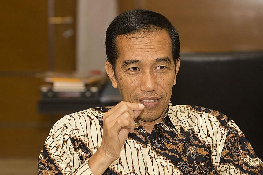 Indonesia's President-elect Joko Widodo. President Joko Widodo is planning a tax amnesty in a bid to convince Indonesians to bring back funds held offshore as he seeks to narrow the current-account deficit. -- PHOTO: SPH FILE