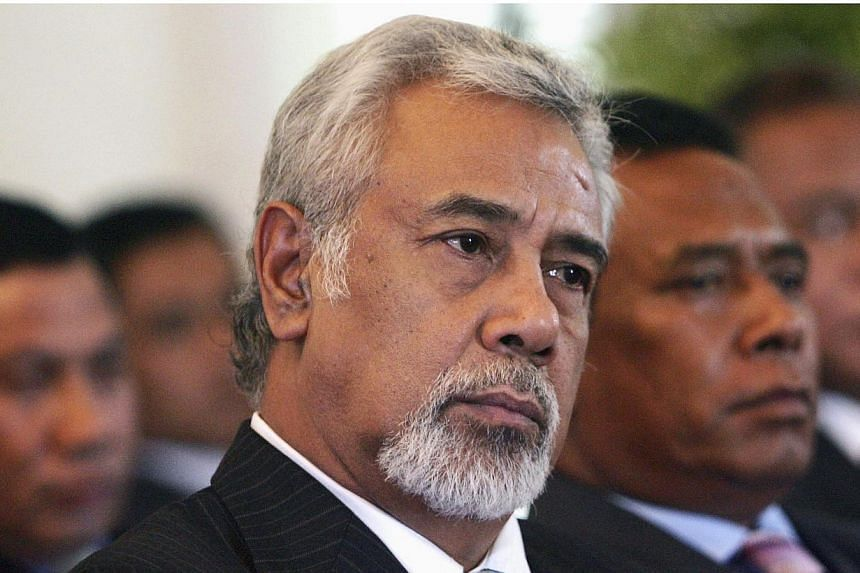 East Timor's Prime Minister Xanana Gusmao (centre) sits with cabinet members as he waits to be sworn in as the new Prime Minister in Dili in this 2012 file photo. -- PHOTO: REUTERS