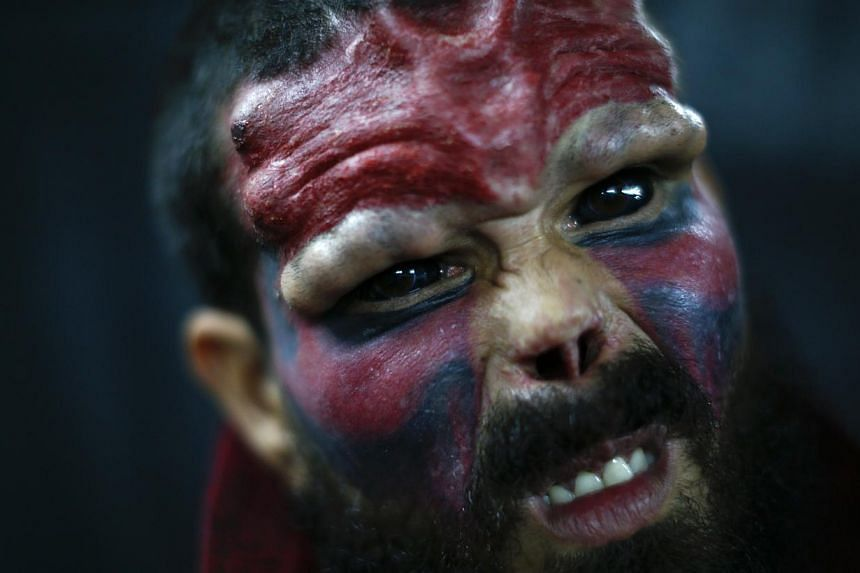 "Body modification artist ""Red Skull"" poses for a picture at Venezuela Expo Tattoo in Caracas Jan 29, 2015. -- PHOTO: REUTERS"